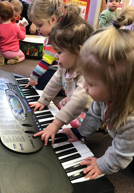 Children playing on the keyboard